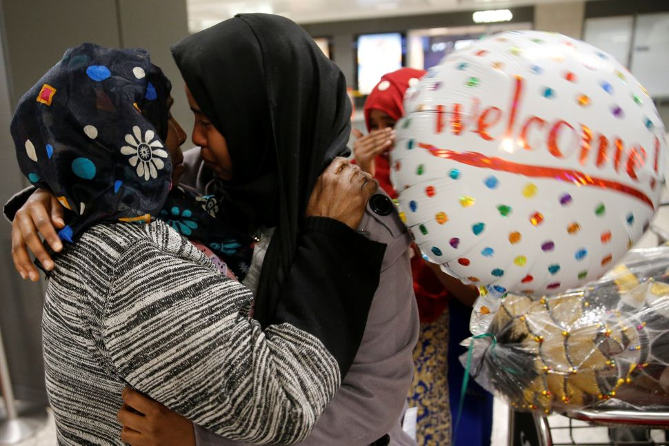 Roodo Abdishakur, left, a Somali national who was delayed entry to the U.S. because of the recent ban, is greeted by her moth