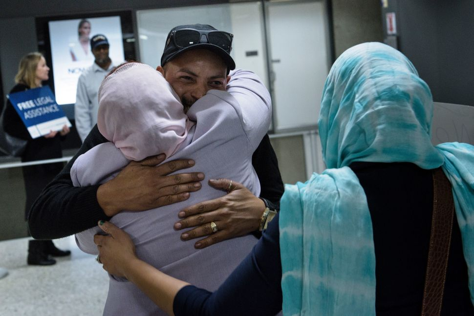 Salwa Tabiedi greets her son Hussamedin Agabani, a Sudanese citizen who was arriving in the United States for the first time,