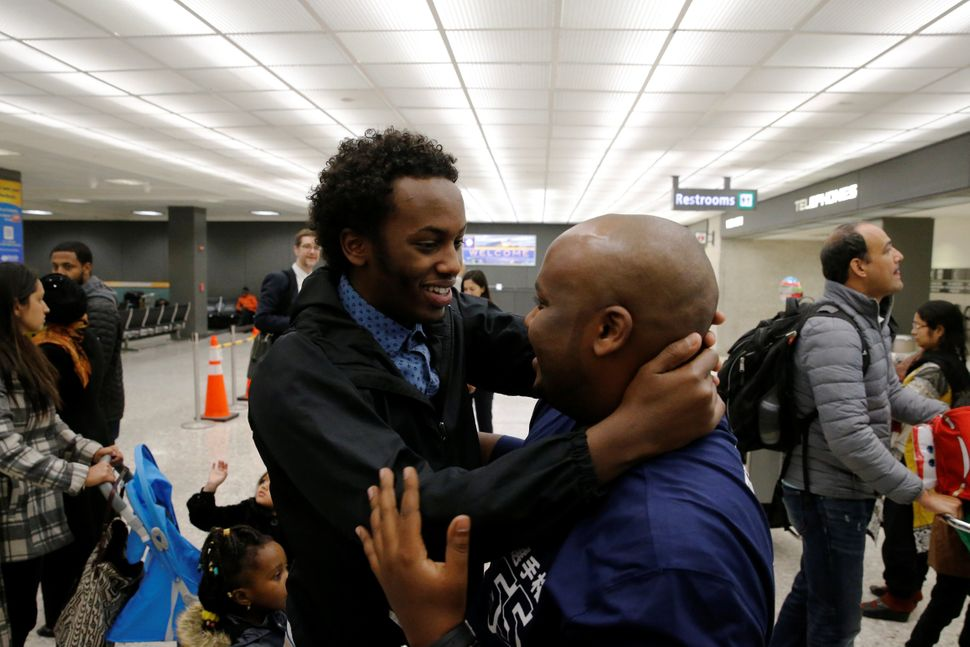 Mustafa Aidid, right, a Somali national who was delayed entry into the U.S. because of the Jan. 27 travel ban, is reunited wi