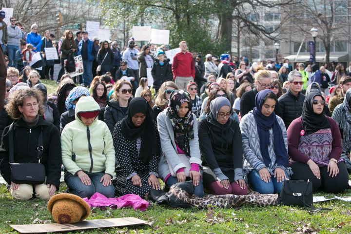 People of all faiths and religions join in a Muslim prayer during an Interfaith Rally for Muslims and Refugees at the Luthera