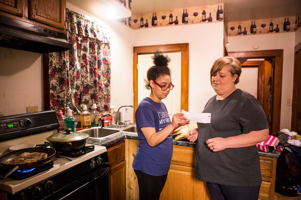 In their kitchen on Jan. 19, 2017, Brianna and Brandi look at mail from Bresha'ssupporters across the globe.