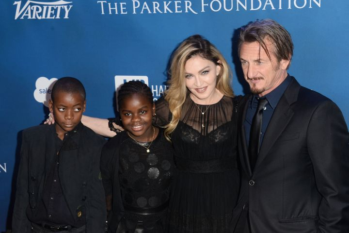 Madonna and Sean Penn pose with the singer's children, David Banda and Mercy James, at the 5th Annual Sean Penn & Fr