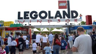 UNITED KINGDOM - MAY 29:  Visitors enter Legoland in Windsor, Berkshire, UK, Sunday, May 29, 2005. Blackstone Group LP, which is seeking to raise a record buyout fund, agreed to buy Lego A/S's Legoland theme parks for 375 million euros ($457 million) to add to its entertainment investments including the London Dungeon.  (Photo by Eleanor Bentall/Bloomberg via Getty Images)