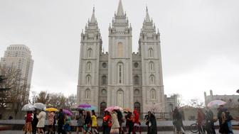 A group of Mormon women walk to Temple Square in an attempt to get tickets to the priesthood meeting at The Church of Jesus Christ of Latter-day Saints semi-annual gathering known as general conference in Salt Lake City, Utah April 5, 2014. The group, who want ecclesiastical equality with men, seeked admittance to a male-only session of the faith's spring conference on Saturday, as they promote the ordination of women into the lay priesthood of The Church of Jesus Christ of Latter-day Saints. REUTERS/Jim Urquhart  (UNITED STATES - Tags: SOCIETY RELIGION CIVIL UNREST)