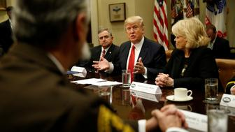 U.S. President Donald Trump speaks during a meeting with county sheriffs at the White House in Washington, U.S. February 7, 2017.  REUTERS/Kevin Lamarque