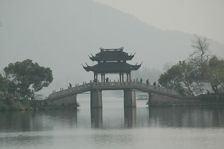 <p><em>A bridge adds to the picturesque quality of West Lake, Hangzhou, China, as charming as it was in Marco Polo's day.</em></p>