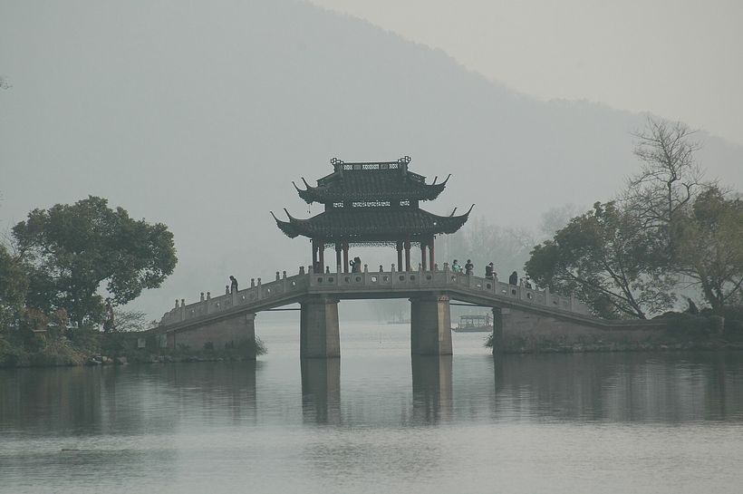 <em>A bridge adds to the picturesque quality of West Lake, Hangzhou, China, as charming as it was in Marco Polo's day.</em>