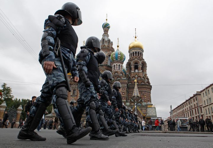"Riot police walk in line during the ""March of Millions"" protest rally, held by opposition supporters, in St. Petersburg, Sept"