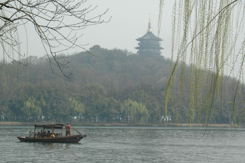 <em>The tranquil </em> <em>scene on West Lake </em>