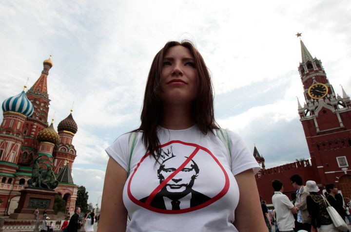 An opposition supporter defends the right of assembly in Red Square, as part of a campaign protesting against Vladimir Putin'
