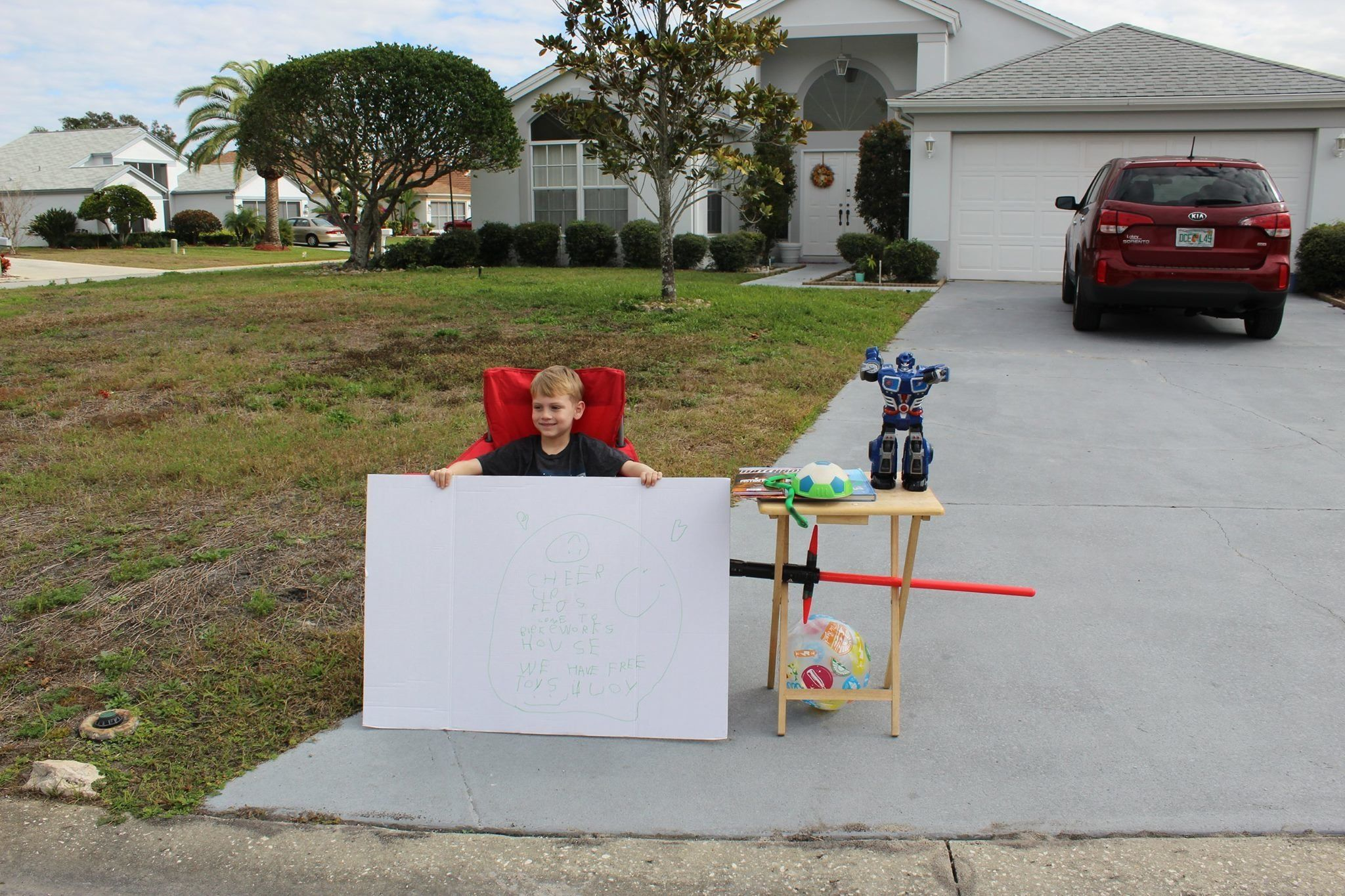 """Blake Work set up a special """"lemonade stand"""" to give away free toys to families in need."""