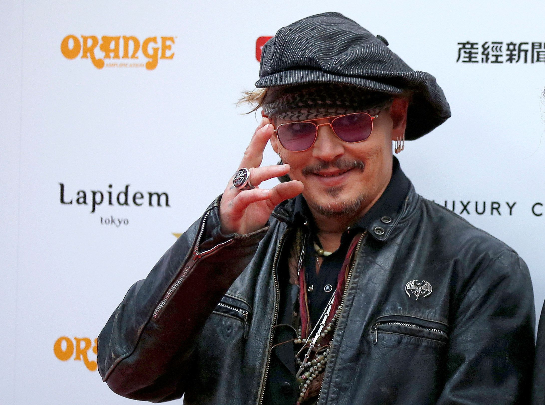 Johnny Depp poses on the red carpet at the 2016 Classic Rock Roll of Honour awards in Tokyo, Japan, November 11, 2016.   REUTERS/Toru Hanai
