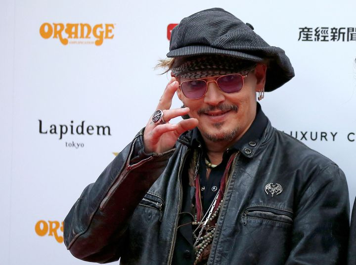 Johnny Depp poses on the red carpet at the 2016 Classic Rock Roll of Honour Awards.