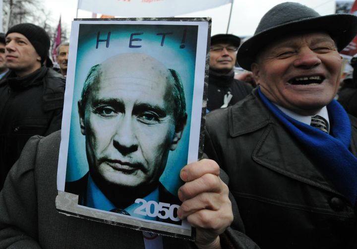 Opposition activists rally at the Bolotnaya Square in central Moscow, on Dec. 10, 2011. The poster depicts Putin looking