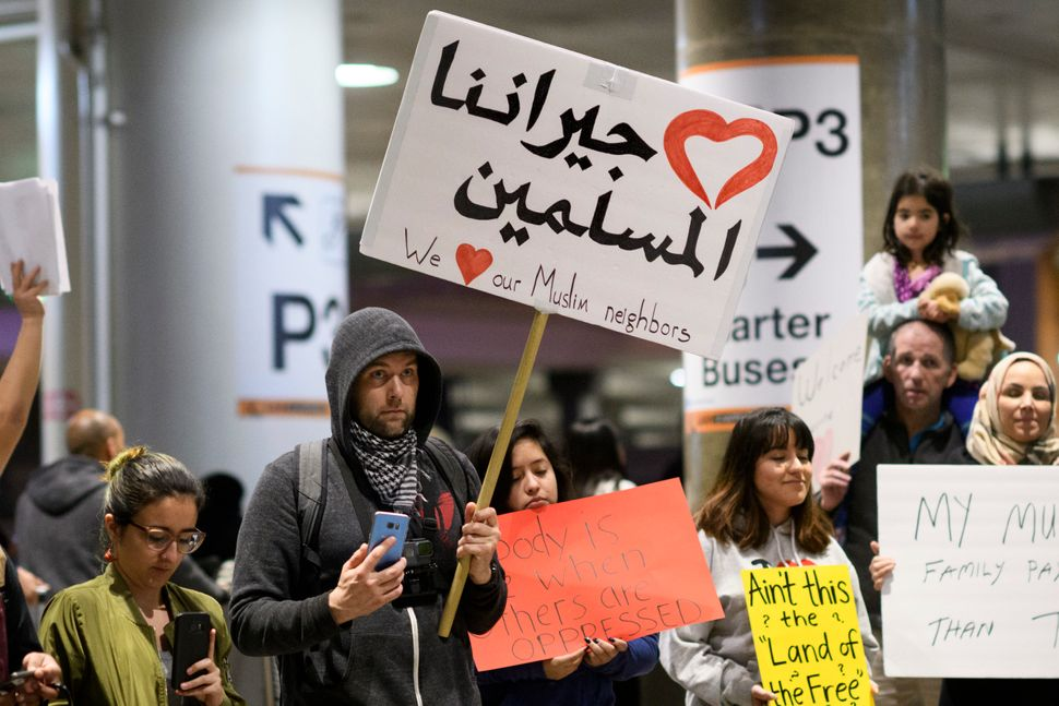 Demonstrators at Los Angeles International Airport protest against President Trump's executive order to ban entry into the US