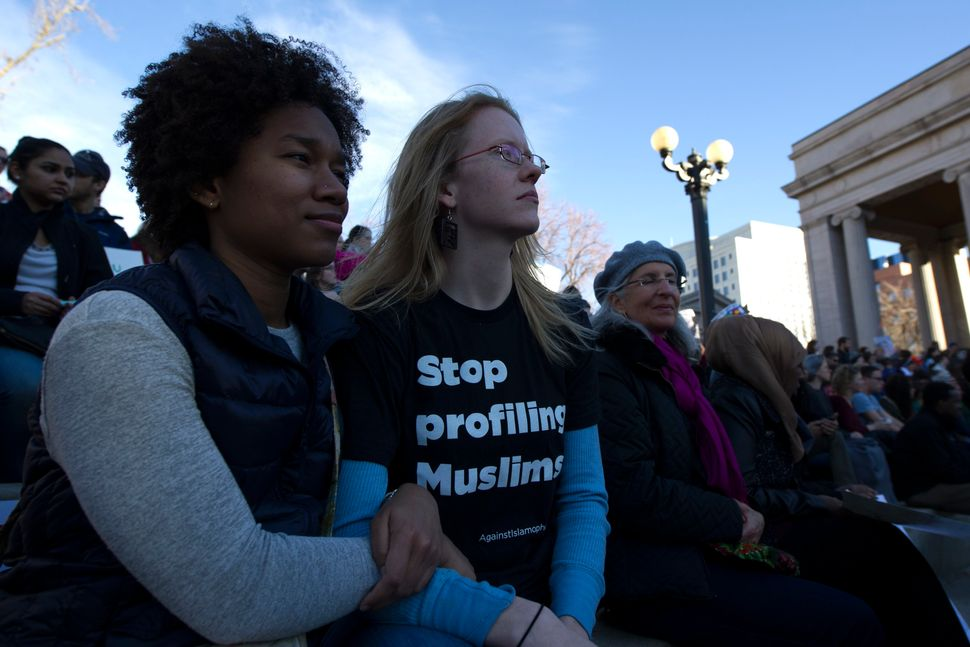 Anyeli Arias (L) and Sara Fossum (R) gather with thousands of people at Civic Center Park in Denver, Colorado for the Protect