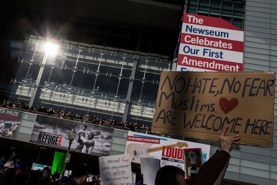 Demonstrators walk past the Newseum while marching from the White House to the Capitol Building on February 4, 2017 in Washin