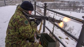 Picture taken on January 14, 2017 shows an Estonian Kaitseliit paramilitary volunteer firing a machine gun in Narva, Estonia. Like other east Europeans, Estonians were deeply disturbed by Russia's 2014 annexation of Crimea and its subsequent support for separatists in eastern Ukraine. US President-elect Donald Trump then raised more concerns with his campaign threat to think twice about defending NATO's eastern allies. These factors coupled with Kremlin sabre rattling in the Baltic region -- especially in its heavily militarised Kaliningrad exclave -- have triggered a paramilitary revival in eastern European states that were under Moscow's thumb during the Soviet era.  / AFP / Raigo Pajula / TO GO WITH AFP STORY by ANNE KAURANEN        (Photo credit should read RAIGO PAJULA/AFP/Getty Images)