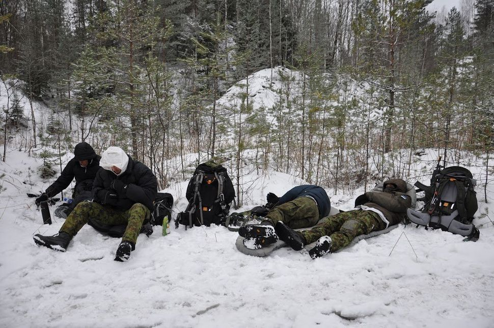 Participants in the Utria Assault rest in a forest near Estonia's border with Russia. Jan. 13.
