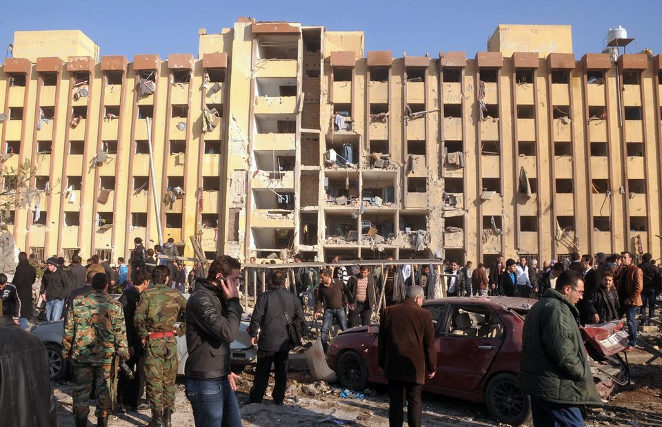Syrian's gather at the scene of an explosion outside Aleppo university, between the university dormitories...