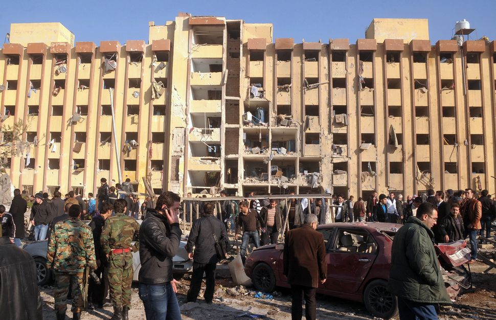 Syrian's gather at the scene of an explosion outside Aleppo university, between the university dormitories and the architectu