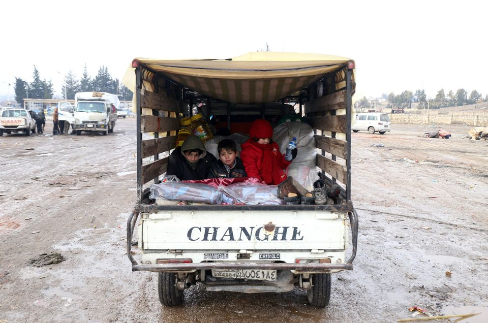 Syrians, who left the last rebel-held pockets of Syria's northen city of Aleppo, arrive on Dec.22,...