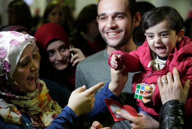 Baraa Hajj Khalaf's daughter, Sham, gets to meet her relatives, including Uncle Mohamad, right, after...
