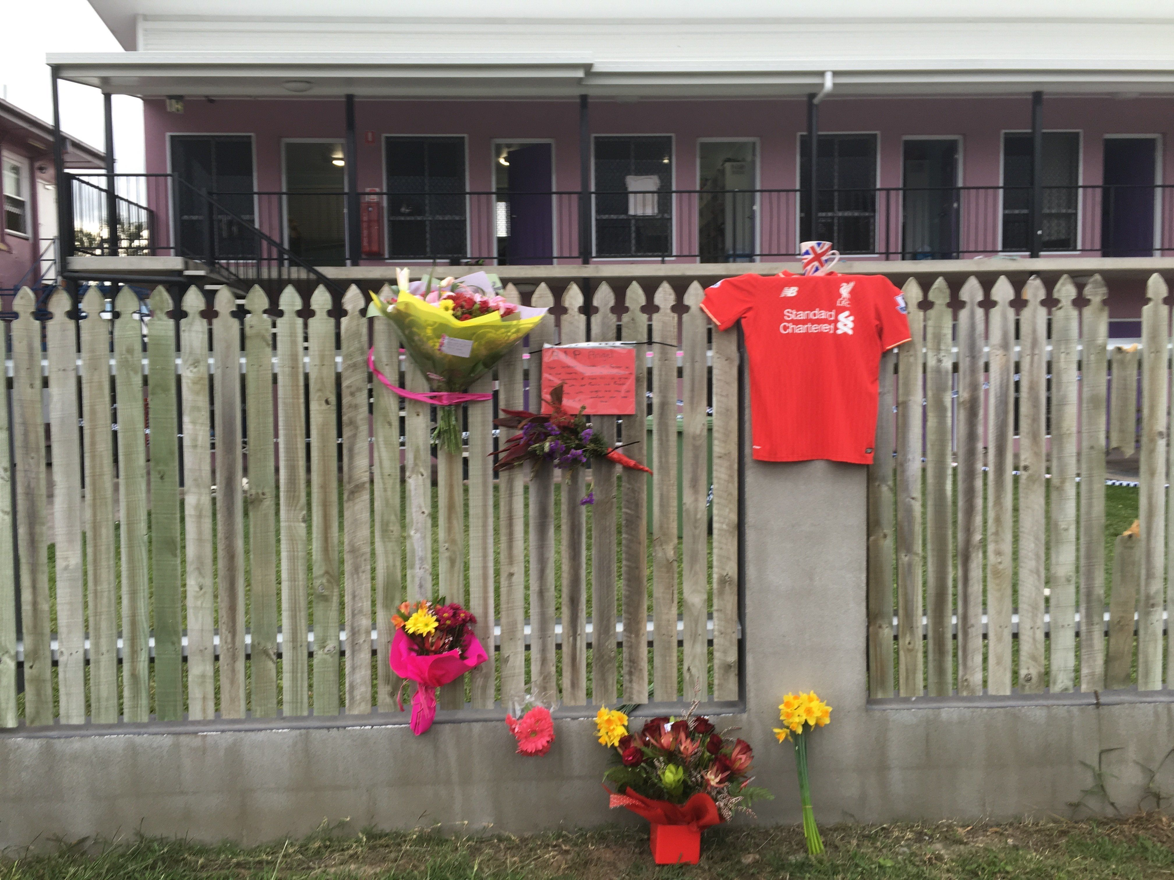 Flowers and well wishes are placed on a fence outside the hostel where British backpacker Mia Ayliffe-Chung, 21, was stabbed multiple times and killed on August 23, 2016 in Home Hill, a rural town in north Queensland state, on August 25, 2016.   A Frenchman was on August 25, 2016 charged with her murder but police found he showed no signs of radicalisation despite saying 'Allahu Akbar' during the attack. / AFP / STR        (Photo credit should read STR/AFP/Getty Images)