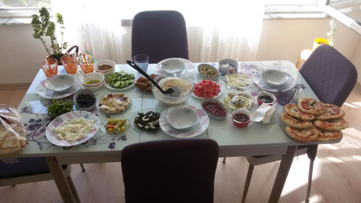A spread of plates that make up a traditional Syrian breakfast.