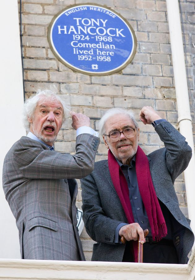 Galton and Simpson outside Tony Hancock's London home, now marked with a blue