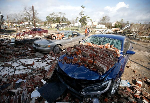 Cars are covered with bricks after a tornado touched down along Chef Menteur Avenue.