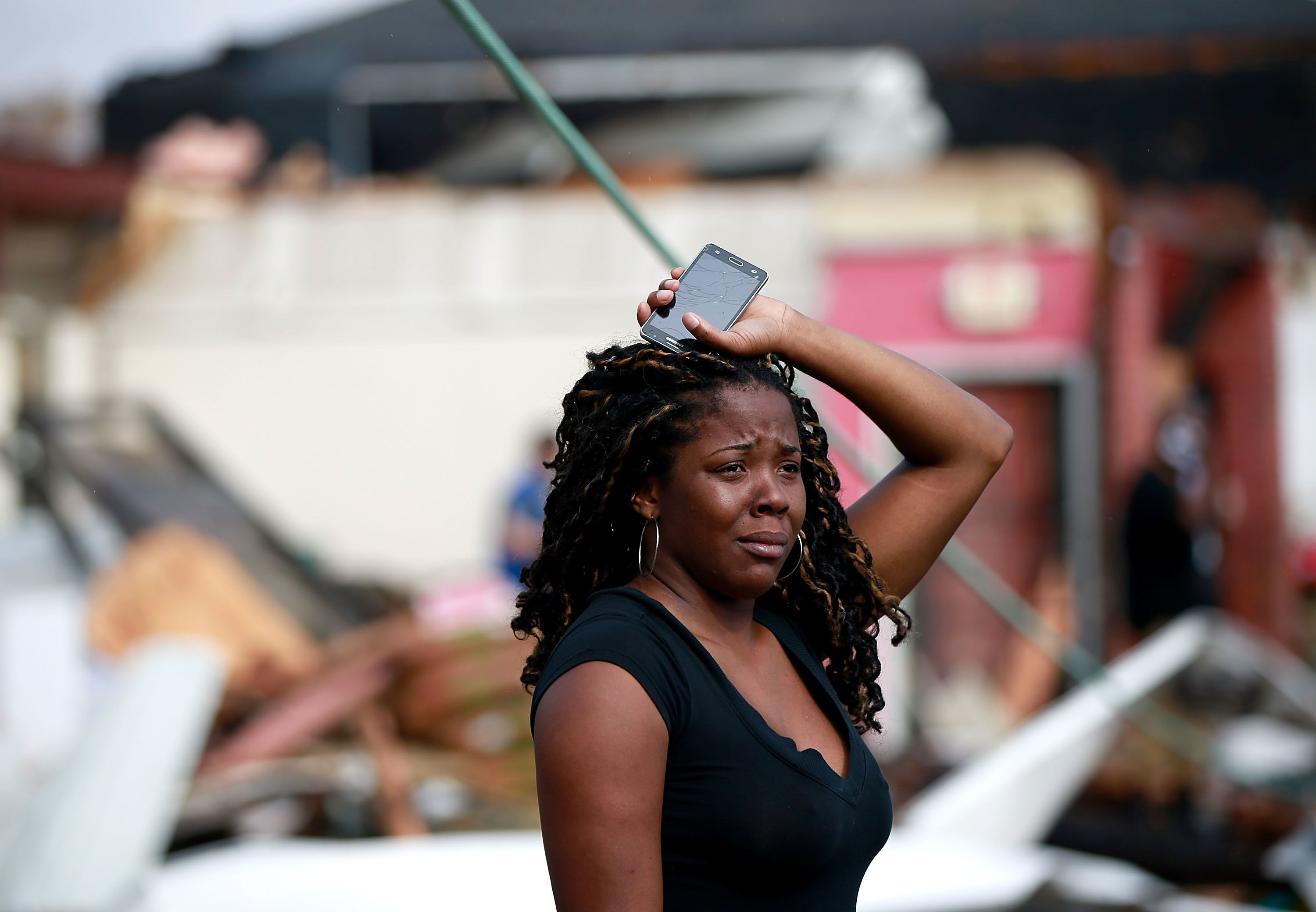 A woman looks at the wreckage caused by a tornado thattouched down along Chef Menteur Avenue on Tuesdayin New Orl