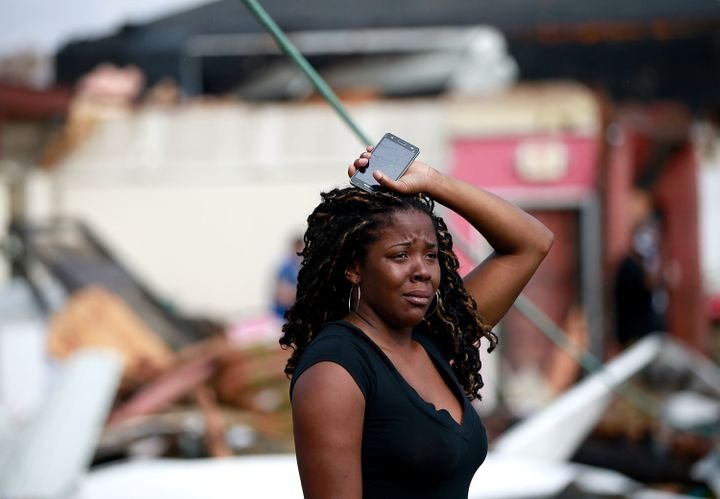 A woman looks at the wreckage caused by a tornado that touched down along Chef Menteur Avenue on Tuesday in New Orl