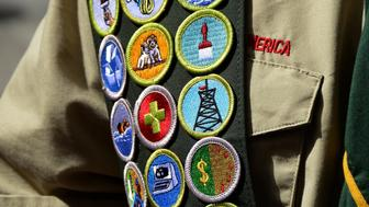 NEW YORK, NY - APRIL 26, 2015: A Boy Scout wears a sash displaying his earned merit badges at a ceremony in New York City. The merit badge sash is worn by a Boy Scout during formal activities and events and not during Troop meetings or campouts. (Photo by Robert Alexander/Getty Images)