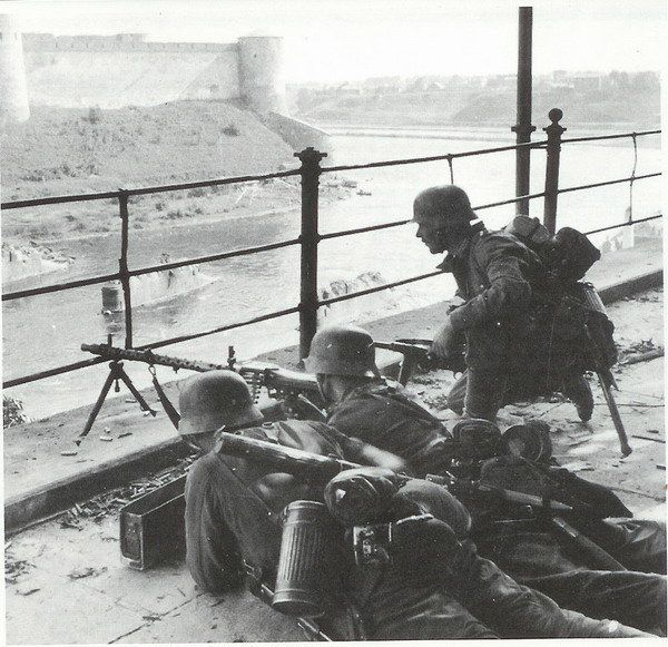 Soldiers defend the western side of the Narva River during the Battle of Narva in