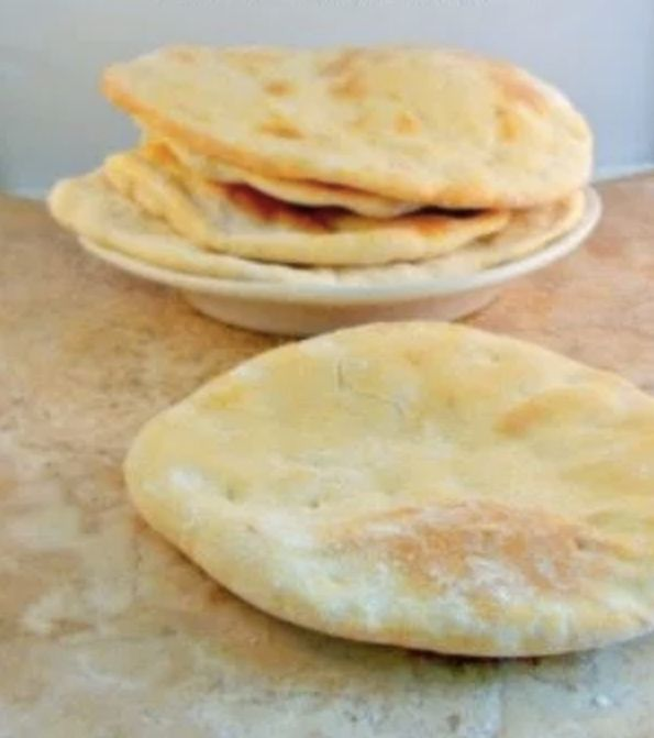 """<strong>Get the <a href=""""https://www.seductioninthekitchen.com/syrian-bread-1-year-later/"""" target=""""_blank"""">Syrian Pita Bread"""