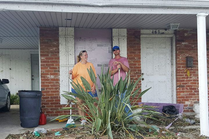 Sharon Walter and her son, Daniel Wilson, clean up debris outside Walter's mother's house.