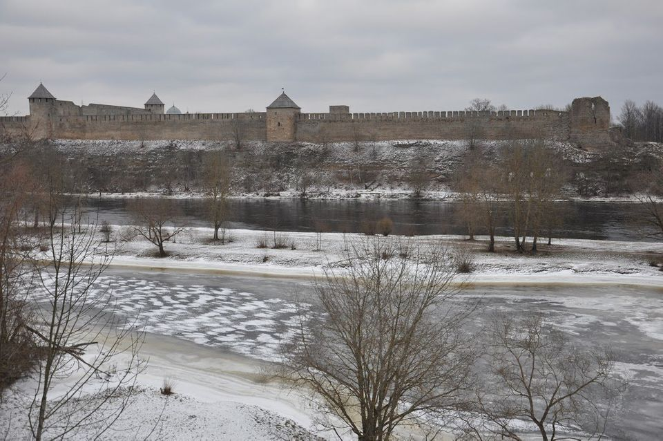 Ivangorod Fortress in Russia seen from the Estonian bank of the Narva River. Jan.
