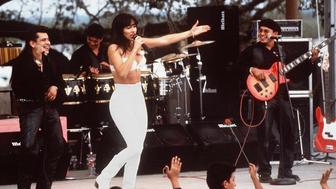 HOLLYWOOD, CA - MARCH 23:  Actress Jennifer Lopez, who plays Selena in the movie 'Selena,' performs with her band in one of the scenes from the movie.  'Selena' is about the tejano singer who is murdered by her fan club president.  (Photo credit should read RICCO TORRES/AFP/Getty Images)