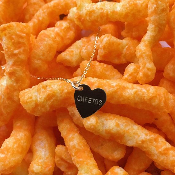"<i>Buy it <a href=""https://www.etsy.com/listing/468451238/cheetos-heart-charm-necklace?ref=shop_home_active_1"" target=""_blank"