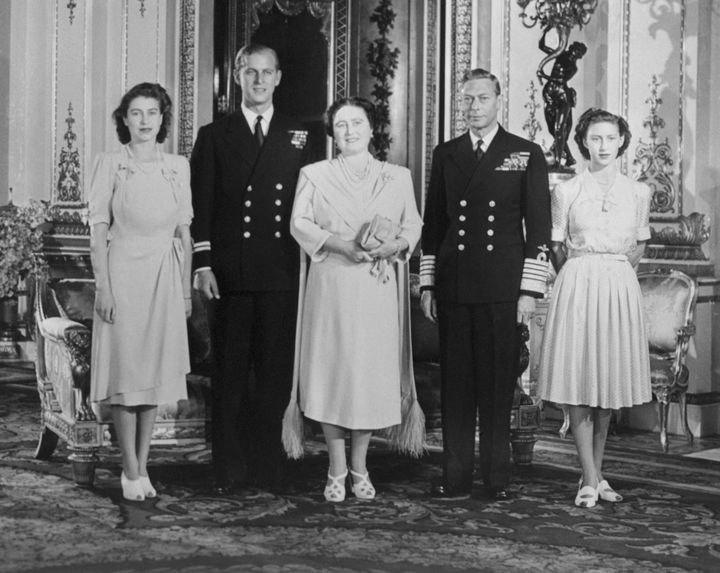 Then-Princess Elizabeth, Philip, then-Queen Elizabeth, King George VI and Princess Margaret Rose in the White Drawing Room of