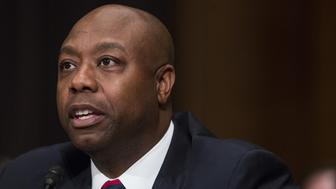 Senator Tim Scott, a Republican from South Carolina, speaks during a Senate Health, Education, and Labor Committee confirmation hearing for Betsy DeVos, secretary of education nominee for U.S. President-elect Donald Trump, not pictured, in Washington, D.C., U.S., on Tuesday, Jan. 17, 2017. DeVos said raising costs of higher education need to be addressed, according to prepared remarks for her hearing Tuesday e-mailed by Trump transition team. Photographer: Zach Gibson/Bloomberg via Getty Images