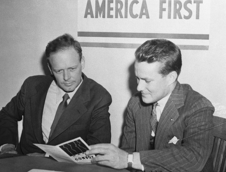 Aviator and America First Committee spokesman Charles Lindbergh, left, warned in 1941 that Jewish Americans threatened t
