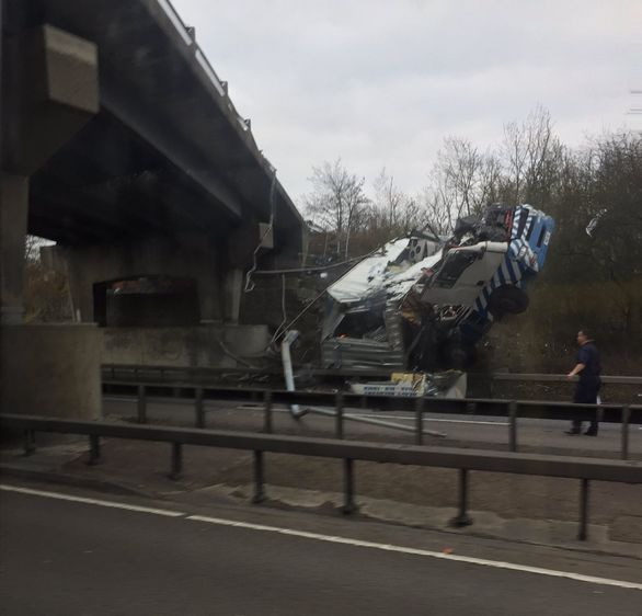Lorry Plunges Off Bridge And Bursts Into Flames On