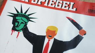 BERLIN, GERMANY - FEBRUARY 05:  The cover of the February 4, 2017 edition of German weekly news magazine 'Der Spiegel' depicts an artist's drawing showing U.S. President Donald Trump holding the severed head of the Statue of Liberty on February 5, 2017 in Berlin, Germany. The drawing, by Cuban-born artist Edel Rodriguez, has ignited controversy, with crisitcs both in Germany and the U.S. claiming it is too provocative.  (Photo by Sean Gallup/Getty Images)