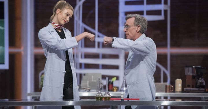 Bill Nye fist bumping with model and correspondent Karlie Kloss.