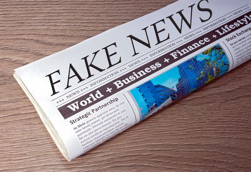 <p>Fake News Newspaper on desk in the office</p>