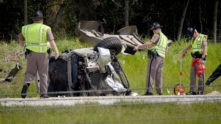 Florida Highway Patrol troopers investigate the scene of a deadly crash involving several vehicles in Lakeland, Florida, in J