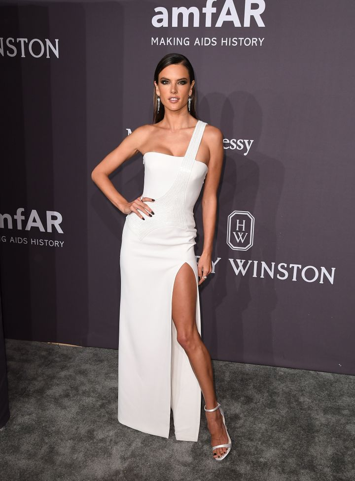 "Fellow supermodel Alessandra Ambrosio pulling an ""Angelina"" pose on the carpet."