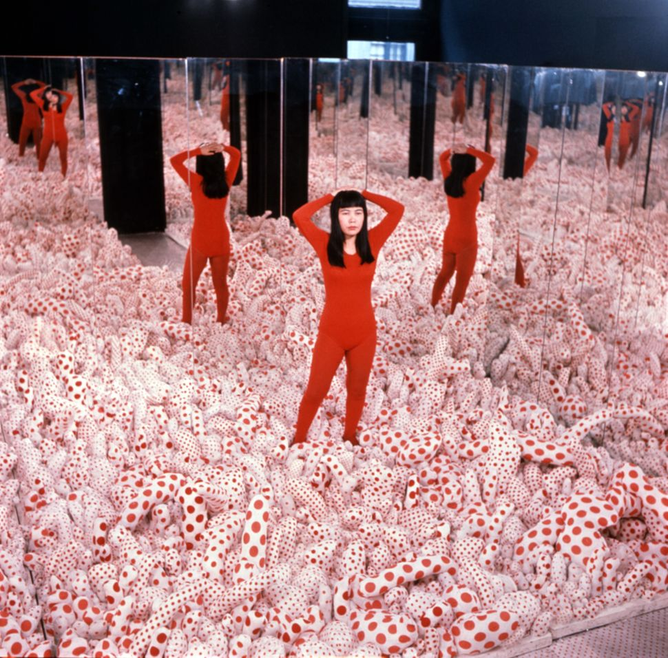 "Yayoi Kusama, again, posing in ""Infinity Mirror Room—Phalli's Field,"" 1965."